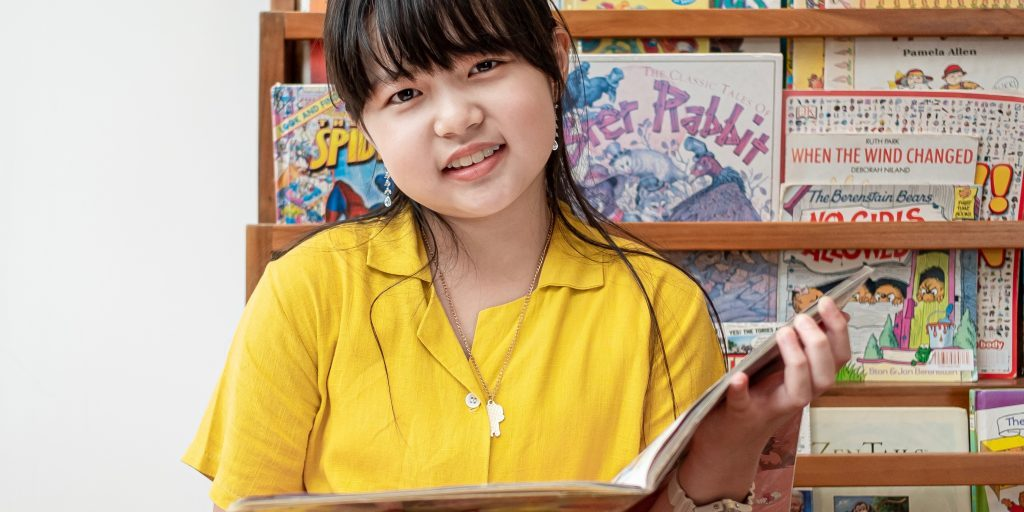 English Student Kids Reading Book in On Campus Library